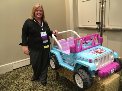 Lori Binko of Lesson Pix with an adapted car that was funded by Easterseals